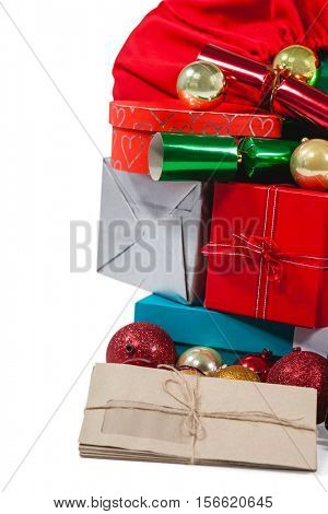 Various christmas presents and baubles against white background