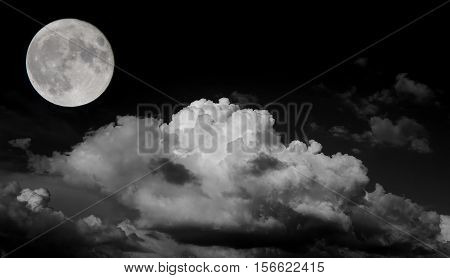 Big moon on cloudy sky in black and white