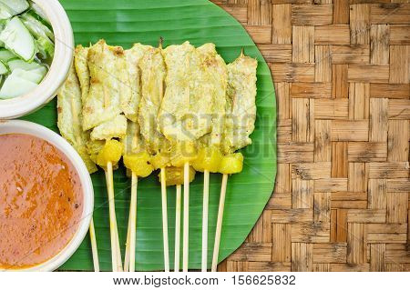 Grilled Pork Satay With Peanut Sauce And Vinegar On Woven Bamboo Background, Thai Food.