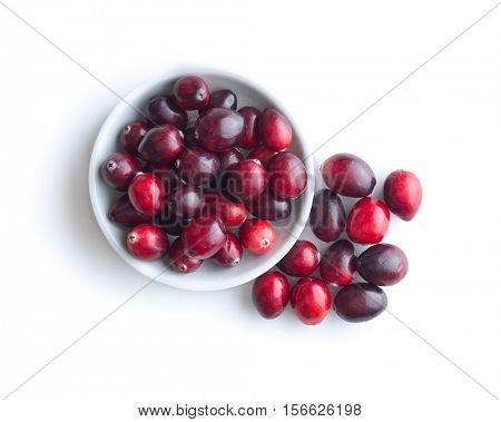 The tasty american cranberries in bowl isolated on white background. Top view.