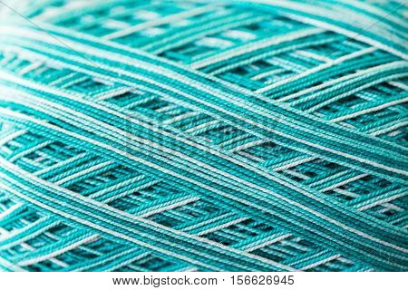 handicraft , knitting and needlework concept - close up of ball of turquoise yarn
