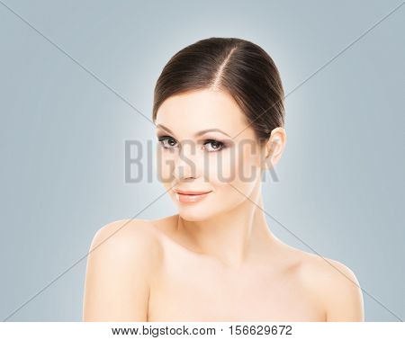 Portrait of young and beautiful woman with smooth healthy skin.
