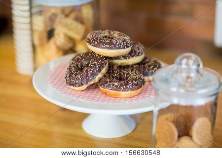 Doughnuts on cake stand in cafe