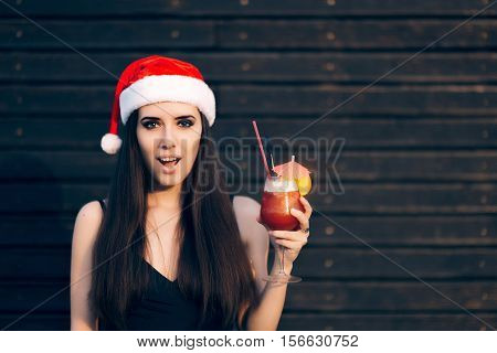 Surprised Woman Holding Cocktail Drink at Christmas Party