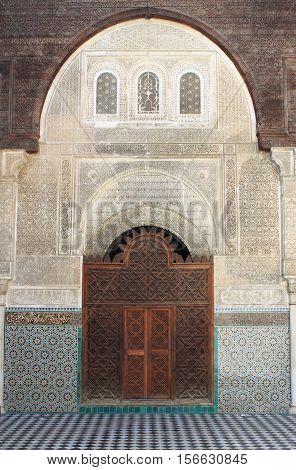 FES MOROCCO - MAY 12: The Al-Attarine Madrasa on May 12 2013 in Fes Morocco. Al-Attarine is a madrasa in Fez medina near the Al-Qarawiyyin Fez Mosque
