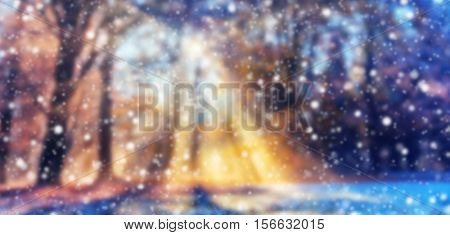 Abstract blur winter background with falling snow flakes