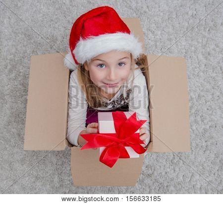 box surprising little girl with santa hat