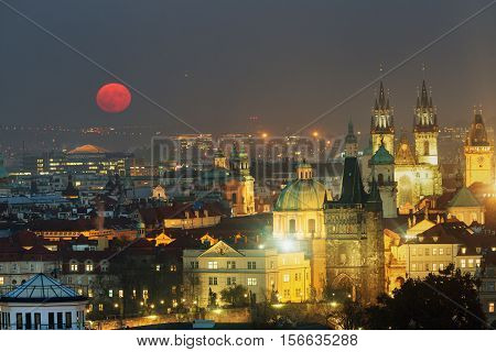 Full moon in Prague Old Town panoramic photo view. Towers of Church of Our Lady before Tyn Prague Czech Republic