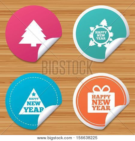 Round stickers or website banners. Happy new year icon. Christmas trees signs. World globe symbol. Circle badges with bended corner. Vector