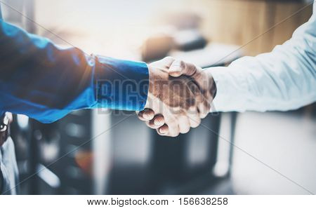 Close up view of business partnership handshake concept.Photo of two businessman handshaking process.Successful deal after great meeting.Horizontal, blurred background