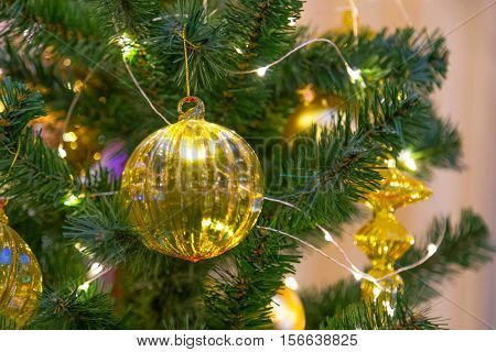 Christmas decorations on the branches of fir tree