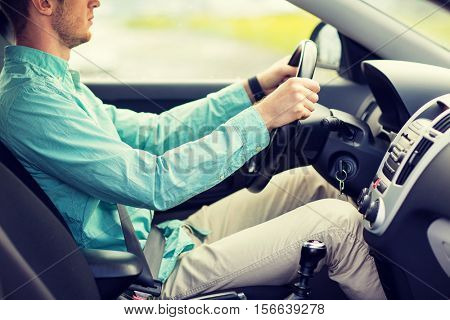 transport, business trip, destination and people concept - close up of young man driving car