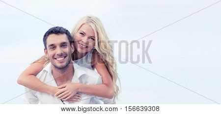 summer holiday, vacation, dating and tourism concept - happy couple having fun on the beach