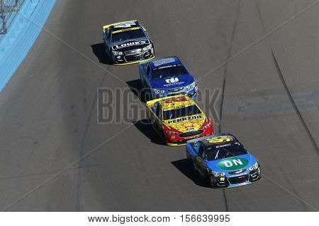 Avondale, AZ - Nov 13, 2016: Joey Logano (22) and Alex Bowman (88) battle for position during the Can-Am 500(k) at the Phoenix International Raceway in Avondale, AZ.