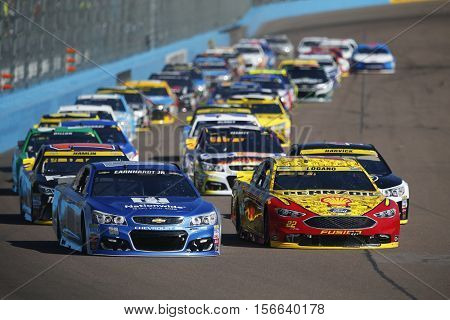 Avondale, AZ - Nov 13, 2016: Joey Logano (22) and Alex Bowman (88) take the green flag during the Can-Am 500(k) at the Phoenix International Raceway in Avondale, AZ.