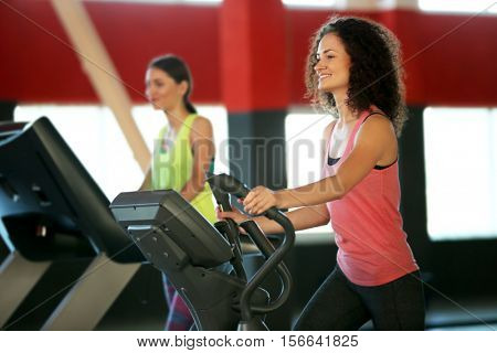 People training on exercise bike in gym