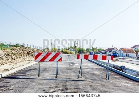 Closed enter at construction zone work in progress sign with boundary are symbols of caution road resurfacing signal.