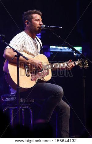 CHICAGO-NOV 9: Brett Eldredge performs at CBS Radio's Stars & Stripes event at the Chicago Theatre on November 9, 2016 in Chicago, Illinois.