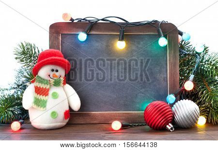 Christmas chalkboard, snowman, fir tree and lights. View with copy space for your text