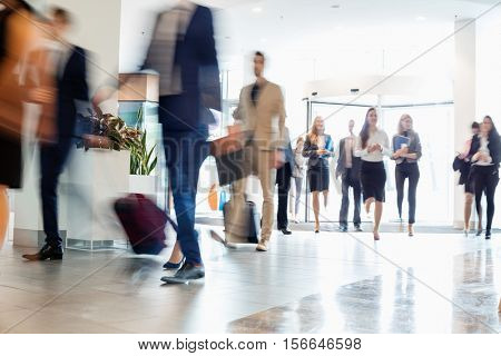 Business people walking at convention center
