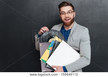 Happy man with vynil in studio. hipster. looking at camera. so happy. isolated black background
