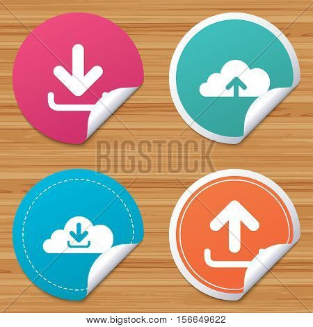 Round stickers or website banners. Download now icon. Upload from cloud symbols. Receive data from a remote storage signs. Circle badges with bended corner. Vector