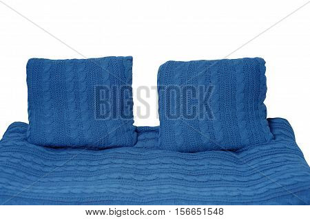 sofa and two pillows in blue isolated on white background.