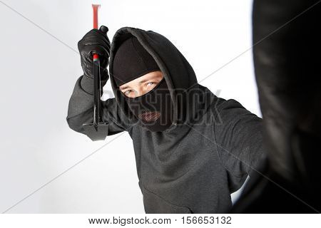 Burglar looks with lock pick