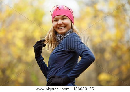 Smiling girl in sport clothes