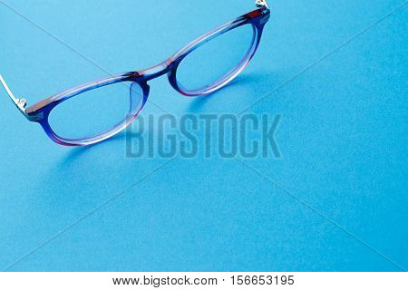 Glasses on pure blue background