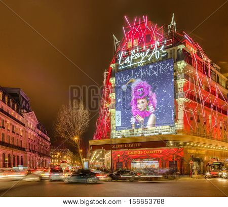ParisFrance- December 21 2014: Night aspect of Galleries Lafayette and The Haussmann Boulevard decorated for winter holidays in Paris on December 21 2015.