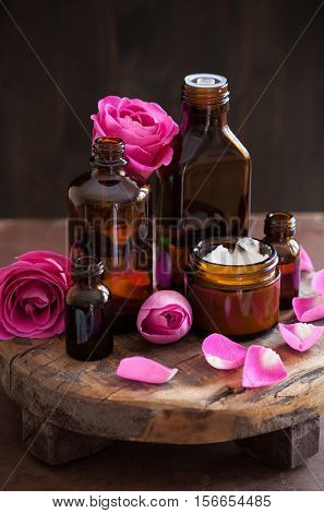 natural cosmetic in glass jars and rose flowers aromatherapy spa