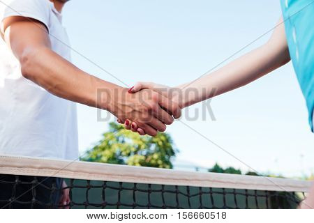Tennis players. cropped image. They greet each other