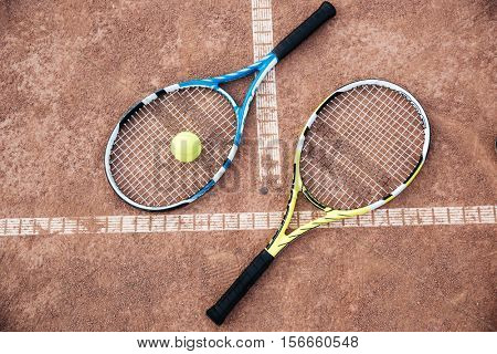 Tennis racquet on court. with tennis balls