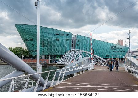 Amsterdam Netherlands - August 1 2016: Contemporary architecture in Amsterdam. Nemo Science Museum a cloudy day