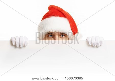 Santa Claus with a banner sales. Santa Claus peeping from behind a banner. Christmas banner sales. Christmas sale.