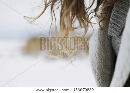woman hair and a detail  of the outfit