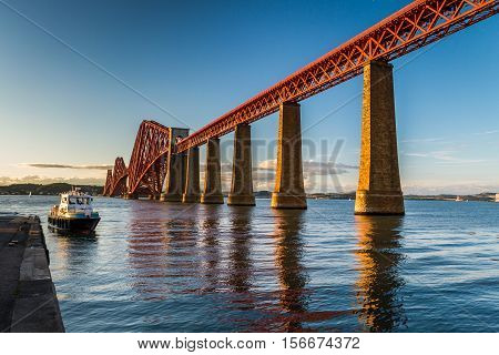 Boat At Sunset In An Old Metal Bridge In Scotland