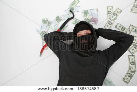 Burglar lying with passkey , money