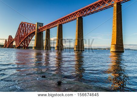 Sunset And Forth Road Bridge In Scotland