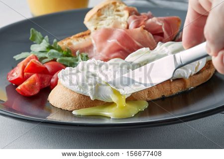 Benedict eggs on buttered wholemeal toast breakfast,