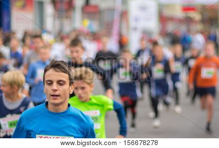 DNEPR UKRAINE - SEPTEMBER 25, 2016:Young participants hurrying to finish line during kids section of
