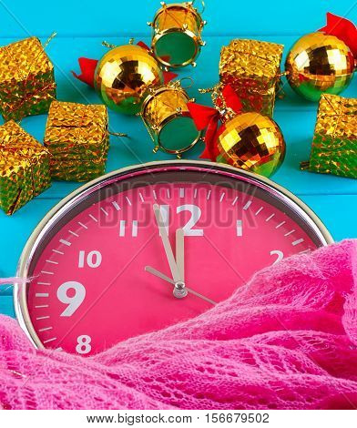Fir tree with christmas decorations alarm clock and gift boxes on blue background