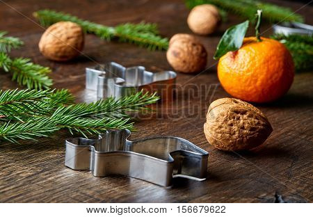 Christmas Cookie Cutters, Mandarins, Walnuts And Spruce Branches