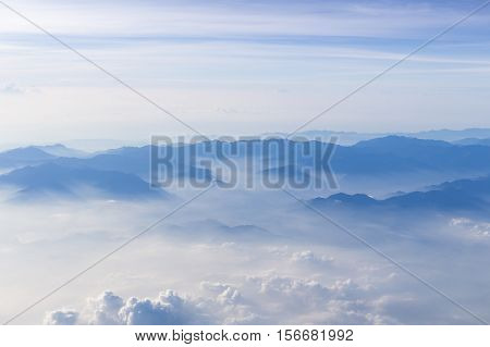 Blue sky and mountains view from airplane stylized hipster background with copyspace.