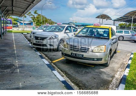 Muara,Brunei-Nov 10,2016:Taxi queued for passengers in Serasa Ferry Terminal at Muara,Brunei Darusallam on 10th Nov 2016.The terminal is about 25km from Bandar Seri Begawan town,Brunei.