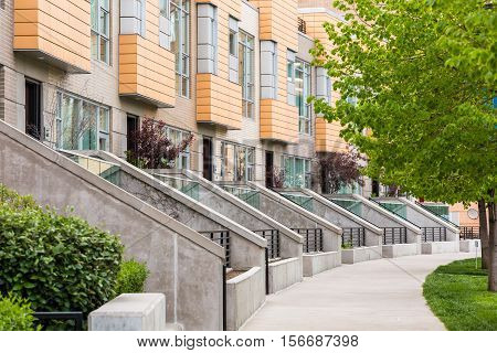 Row of contemporary townhomes at the Riverfront development in Denver Colorado.