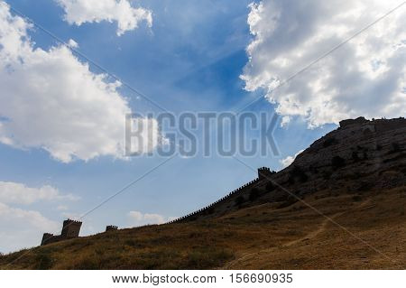 Russia. Crimea. Sudak. Genoese fortress.Sky in clouds, view from below 14.09.2016