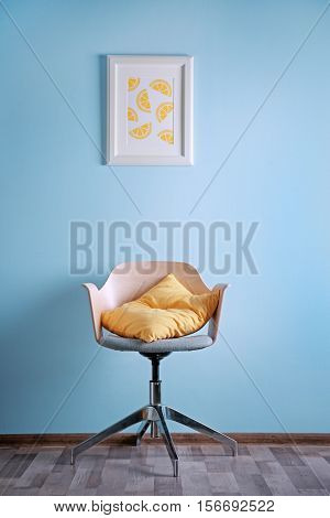 Simple interior with stool and decorations on blue wall background