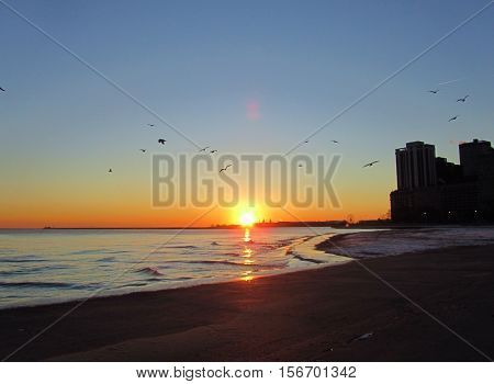 Sunrise over Lake Michigan from Chicago in the winter with a clear blue sky